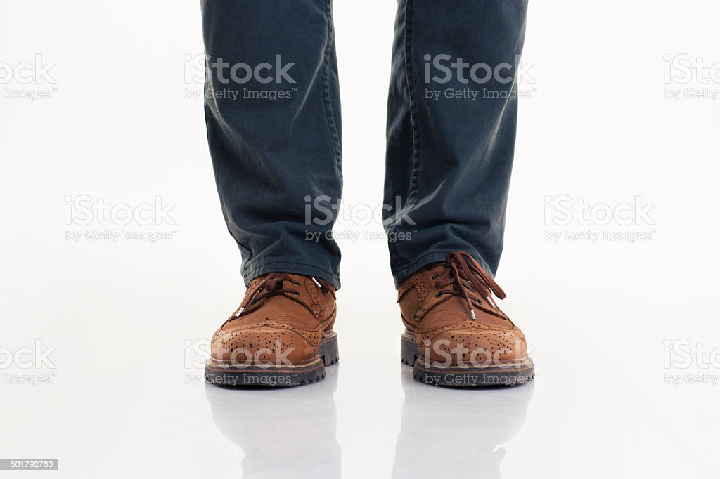 Human legs in jeans and boots stock photo