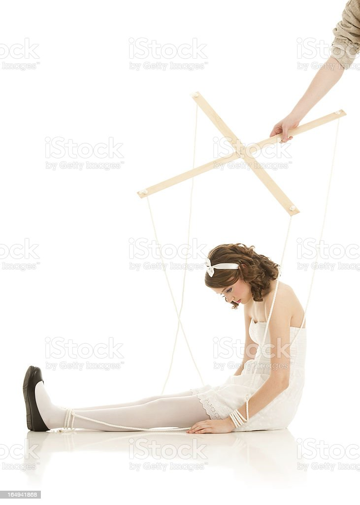 Human Marionette Doll And Puppet Master stock photo