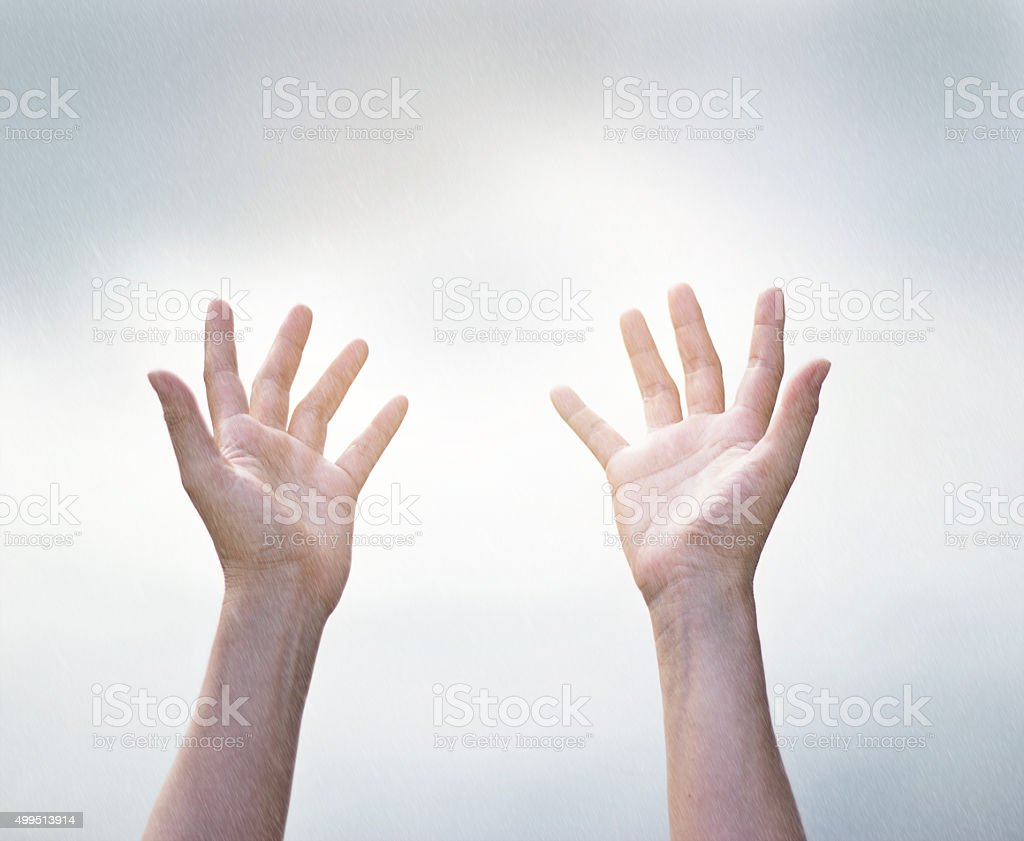 Human open empty hands in rain from the sky stock photo
