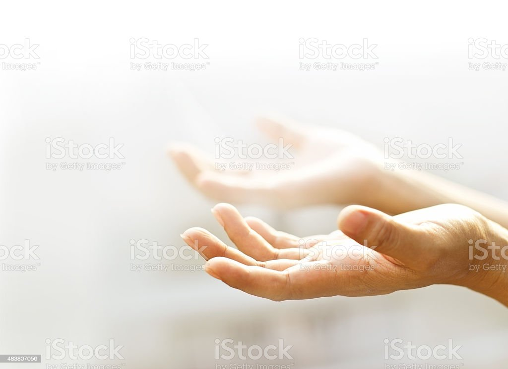 Human open empty hands with light background,  blurred and soft stock photo