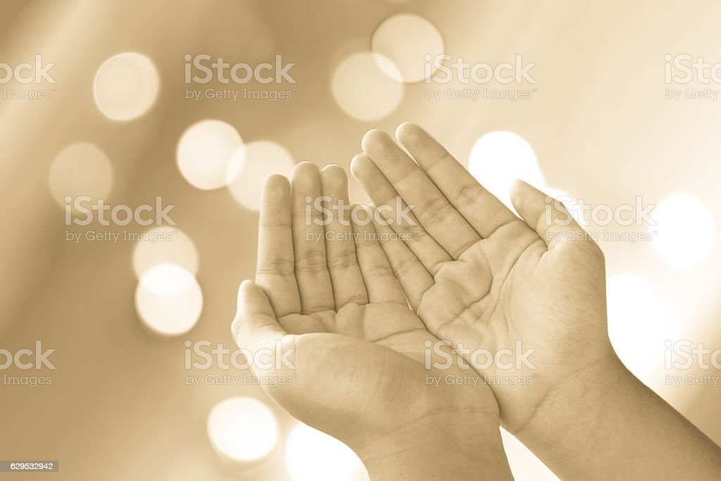 human open empty hands with palms up over blurred background stock photo