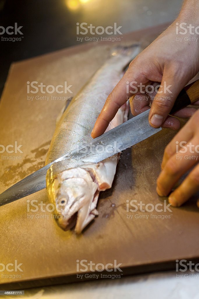 Human preparing fish stock photo