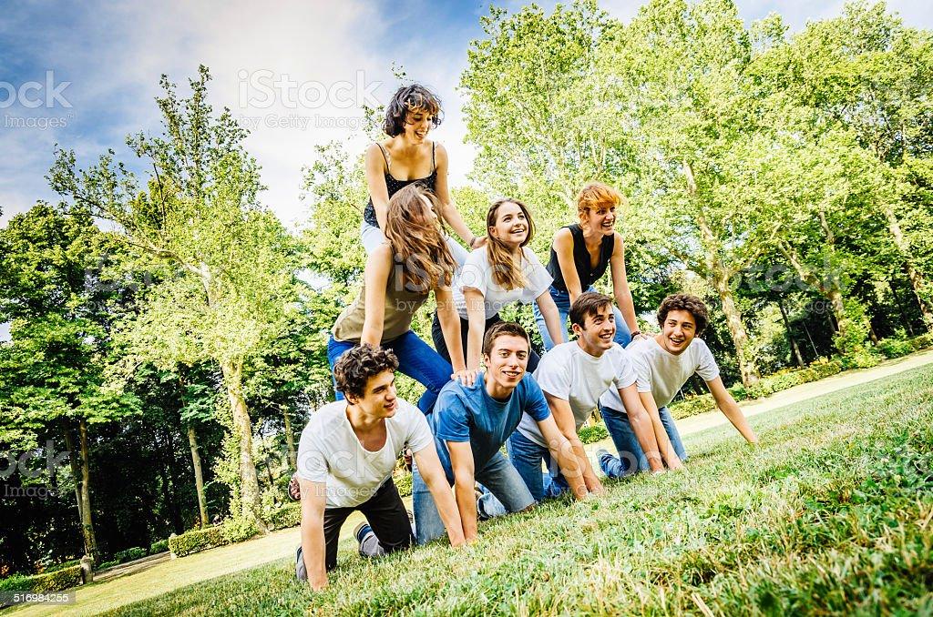 Human pyramid at the park stock photo