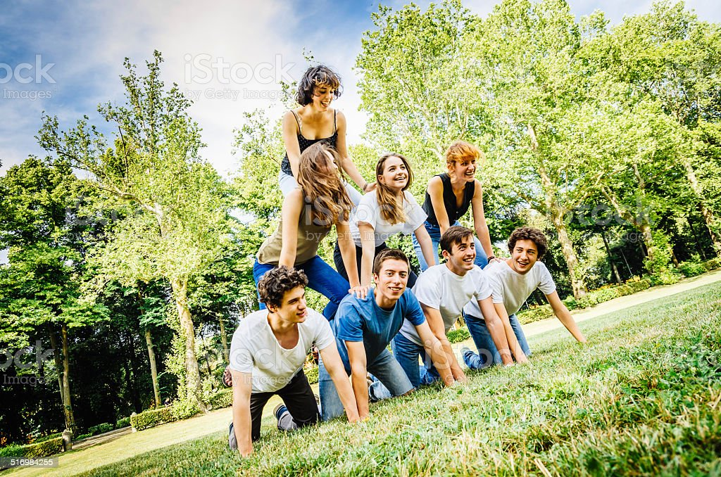 Human pyramid at the park stock photo