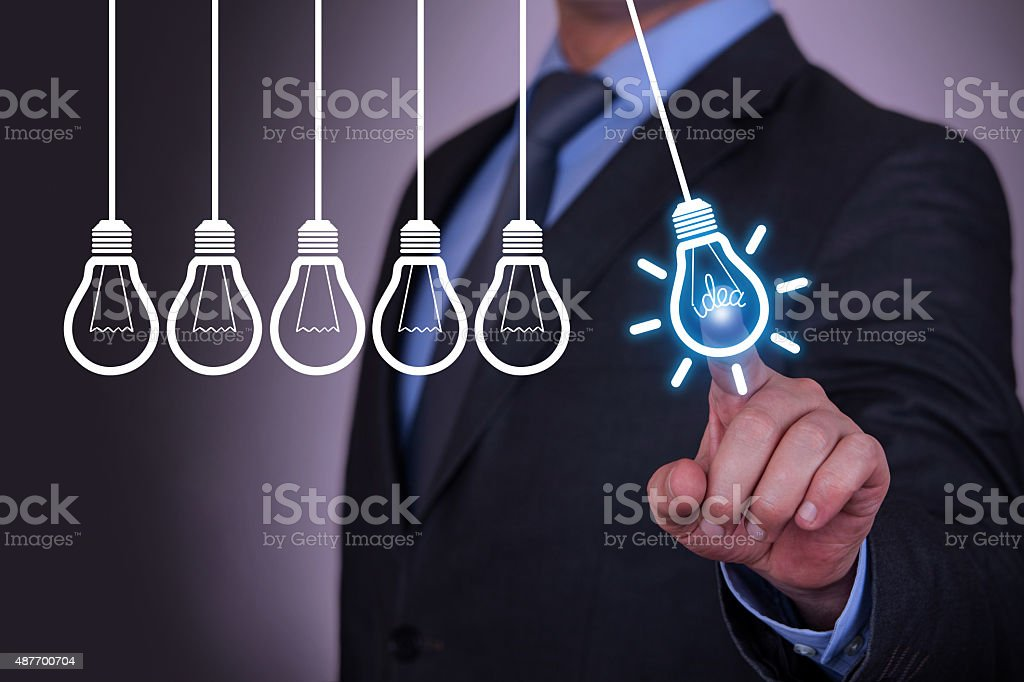 Human Resource Idea Bulb Concepts Touching on Visual Screen stock photo