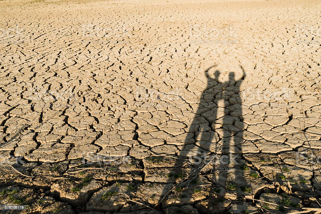 human shadows on a cracked ground stock photo