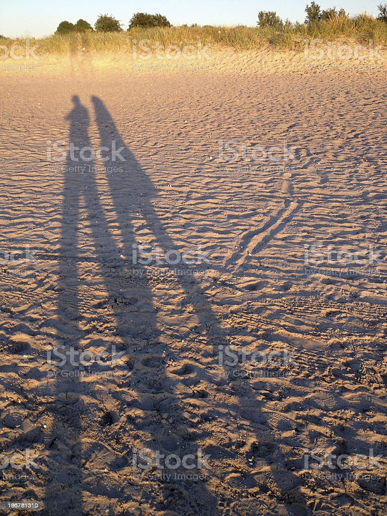 Human shadows on sand. royalty-free stock photo