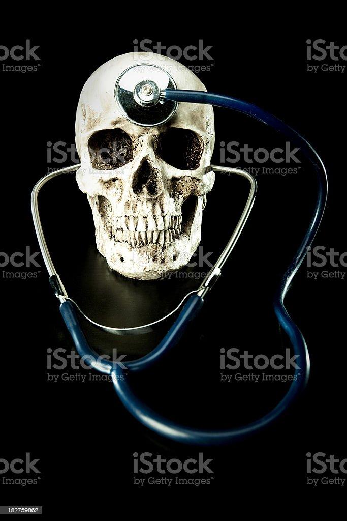 Human Skull and Stethoscope stock photo