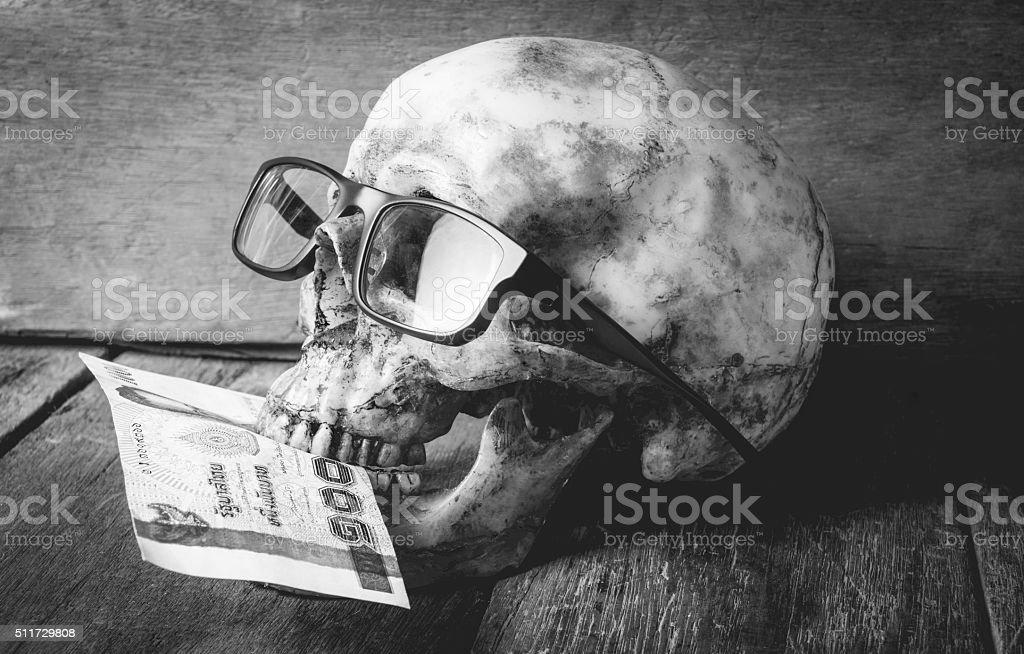 Human Skull Ghost eating Money stock photo