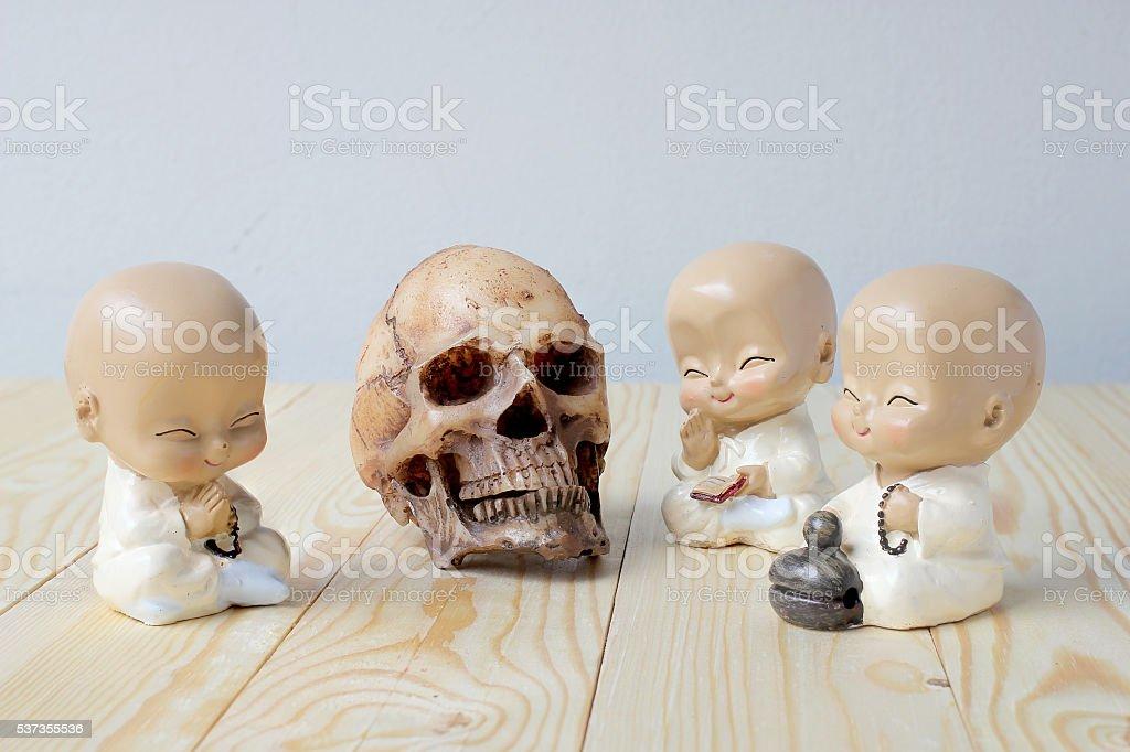 Human skull on old wood background ; still-life stock photo