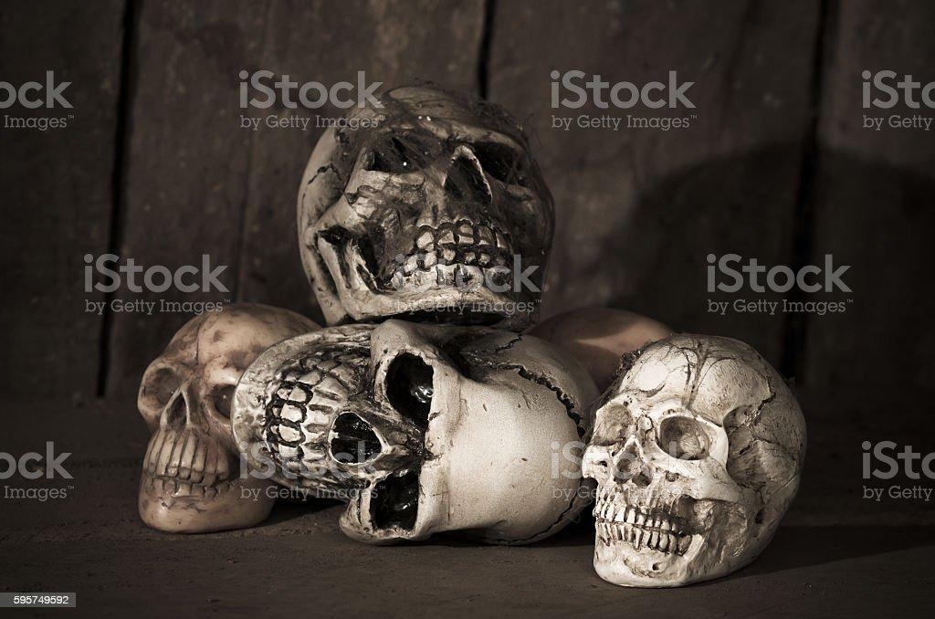 human skull on wood background stock photo