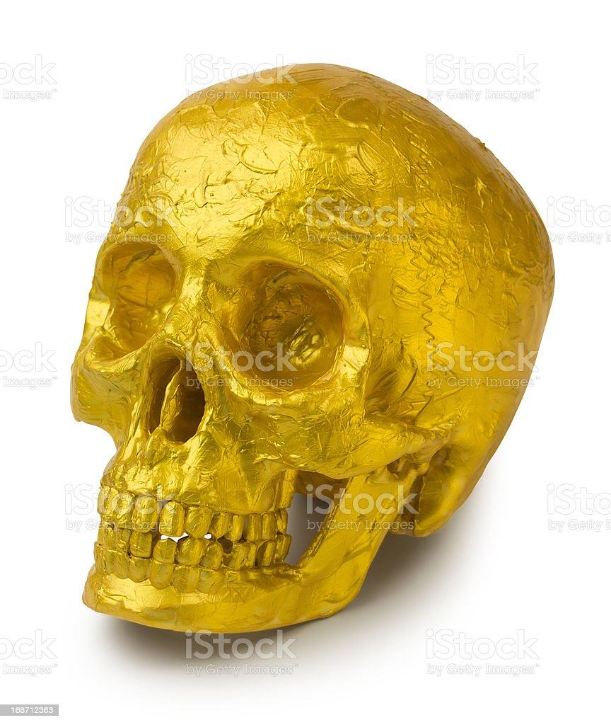 Human skull painted gold or covered in golden leaf royalty-free stock photo
