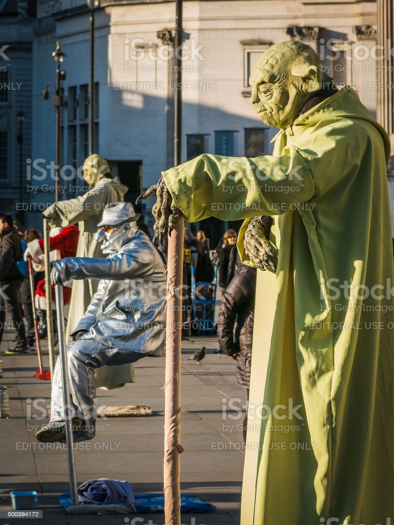 Human statues perform in Trafalgar Square, London stock photo