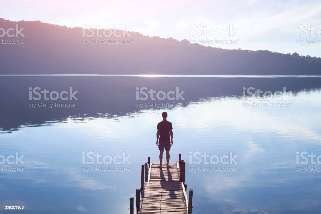 human strength or psychology concept, man standing on pier stock photo