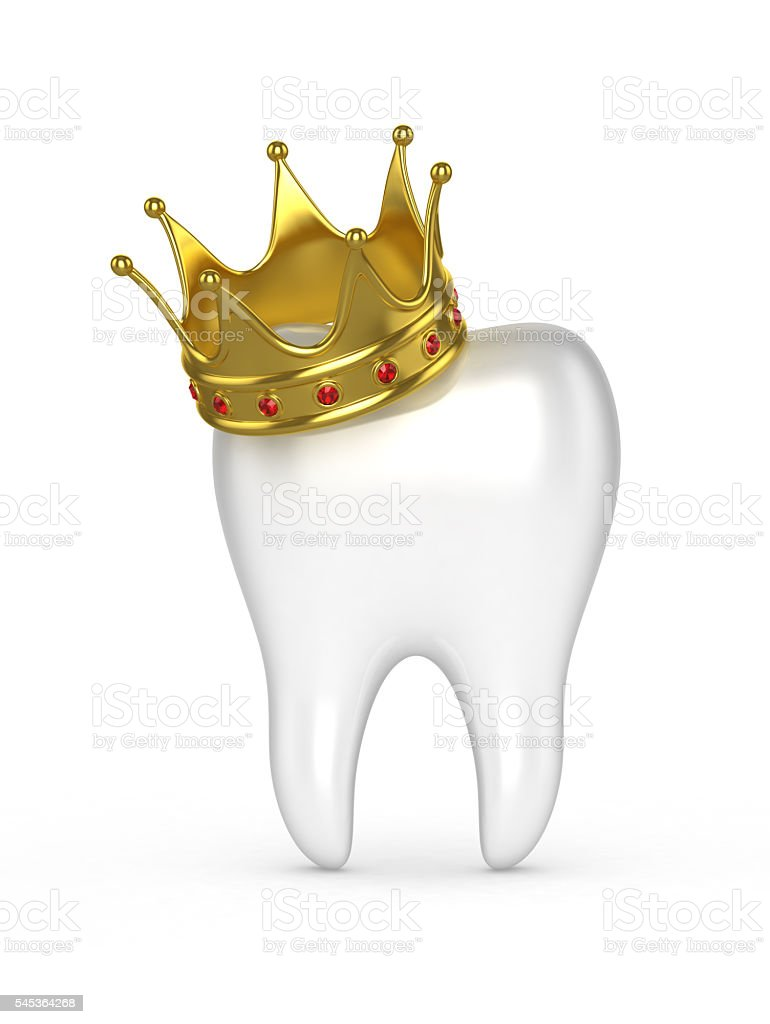 Human tooth with a gold crown on a white background. stock photo