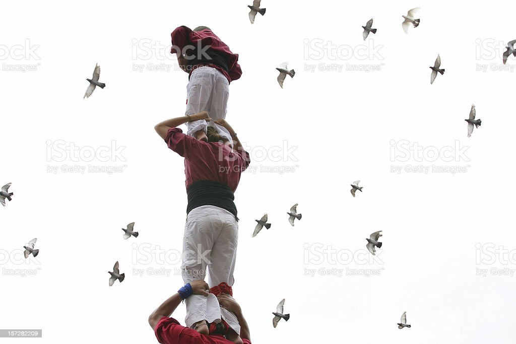 Human tower & doves stock photo