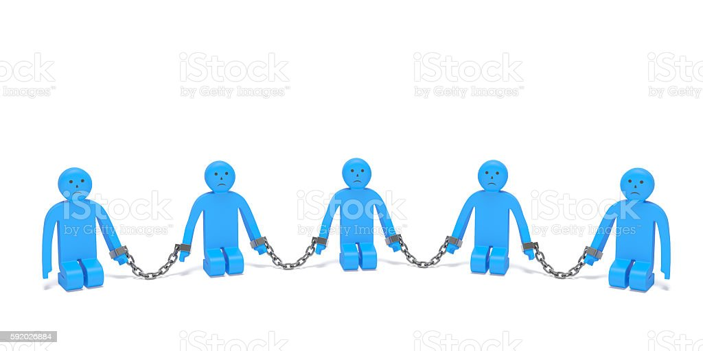 Human trafficking or Slave trade. Kneeling people put into chains stock photo
