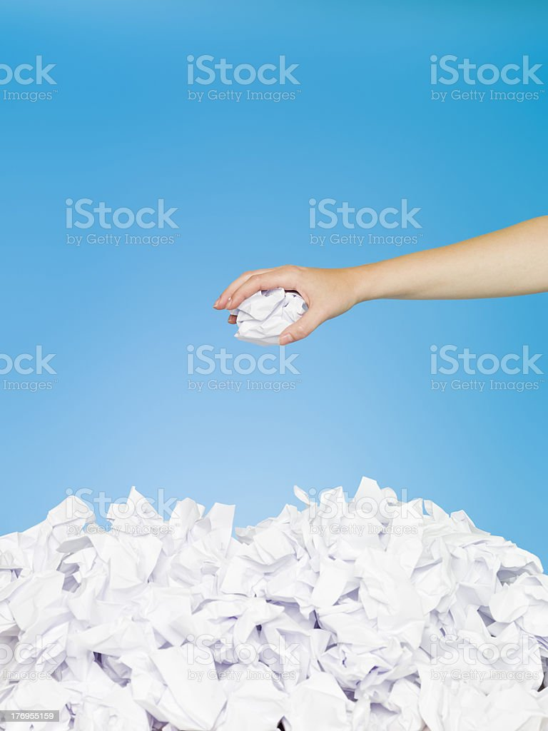 Human trowing a paper royalty-free stock photo