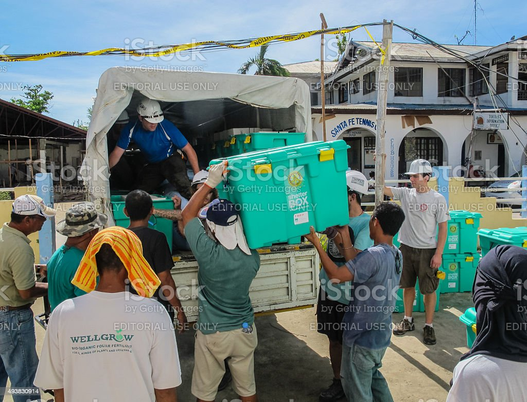 Humanitarian Aid workers loading ShelterBox tents stock photo