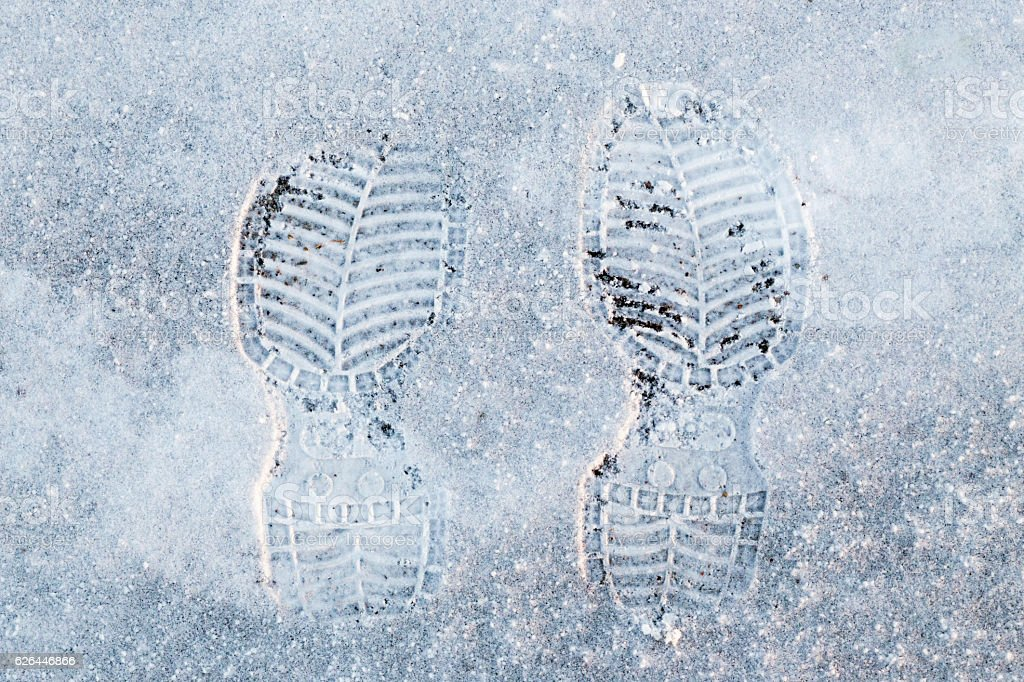Human's foot print on a  snow stock photo