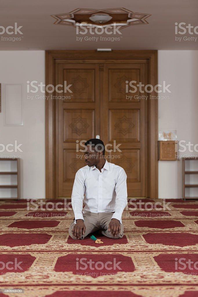 Humble Afro Muslim Prayer stock photo