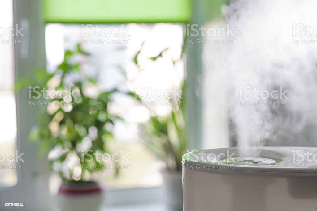 Humidifier spreading steam stock photo