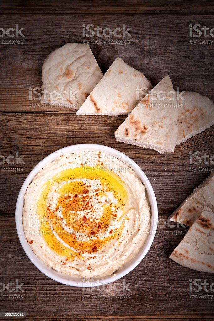 Hummus and pita bread stock photo