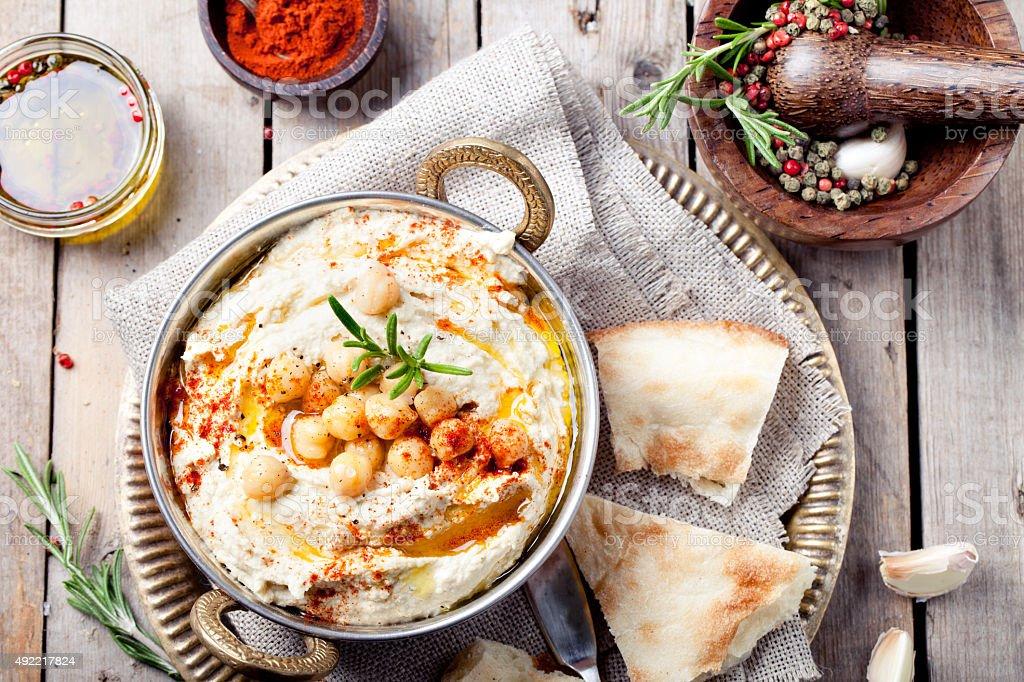 Hummus, chickpea dip, with rosemary, paprika stock photo