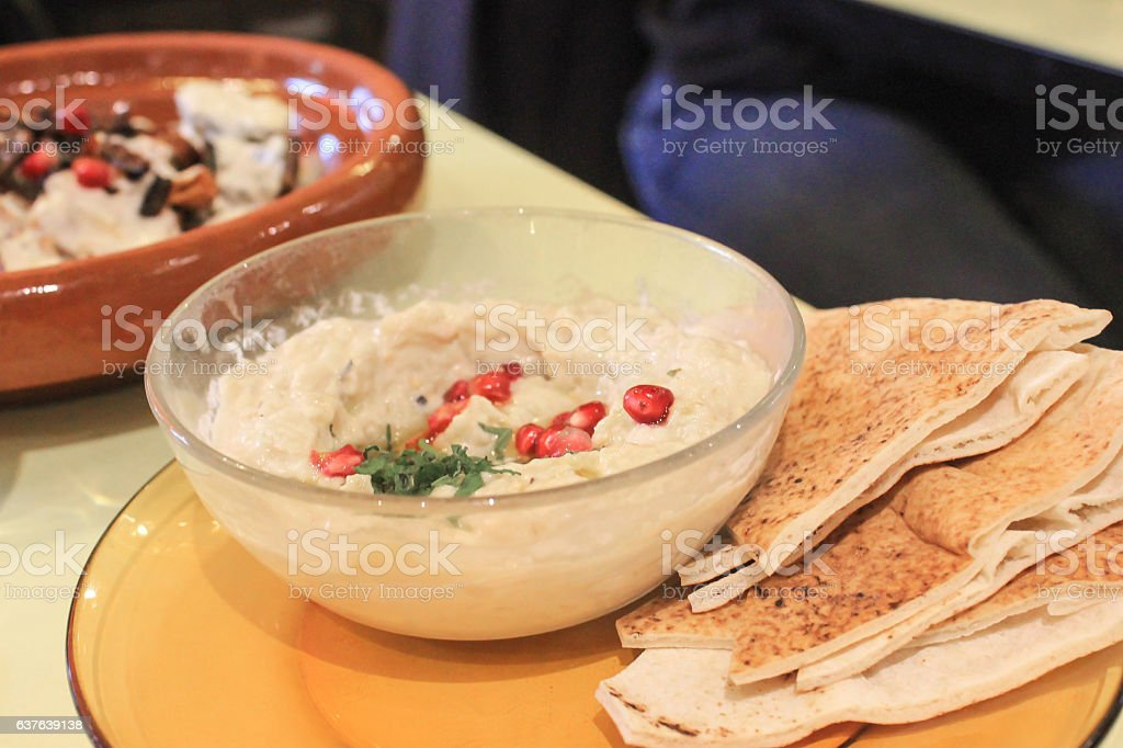 Hummus dip and pita bread stock photo