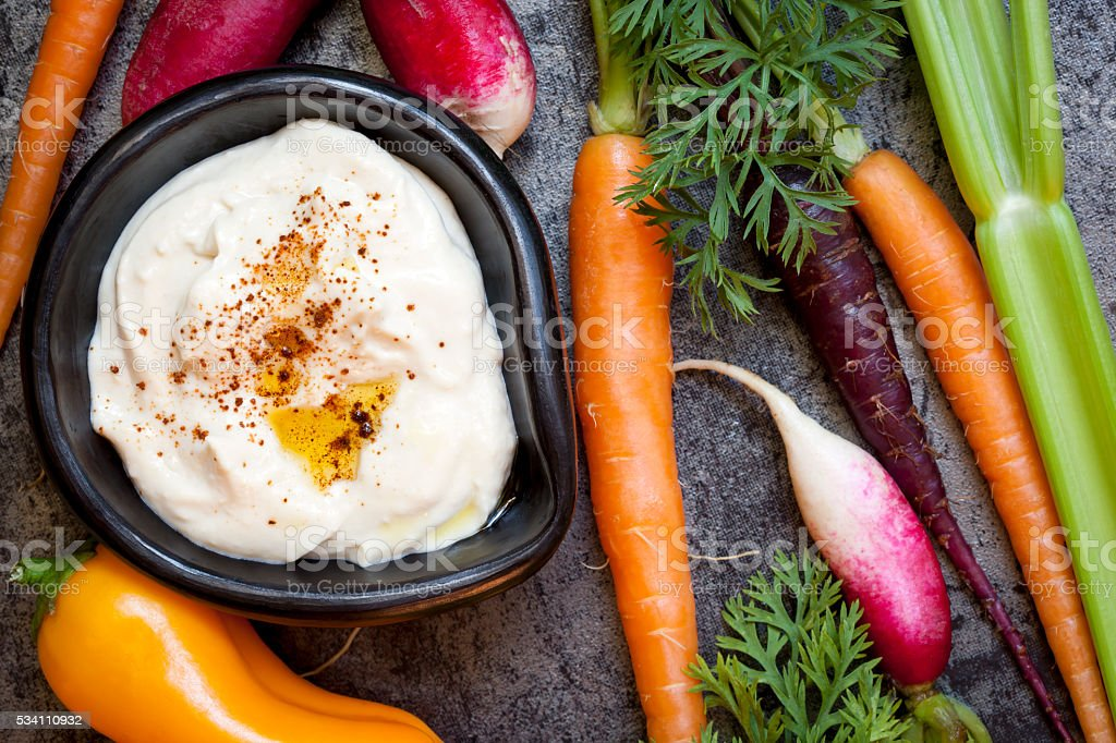 Hummus Dip with Raw Vegetables.  Overhead View. stock photo
