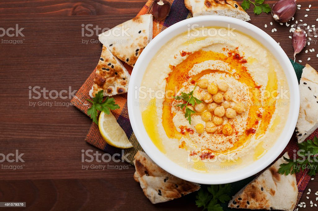 Hummus or houmous, mashed chickpeas with tahini, text copy space stock photo