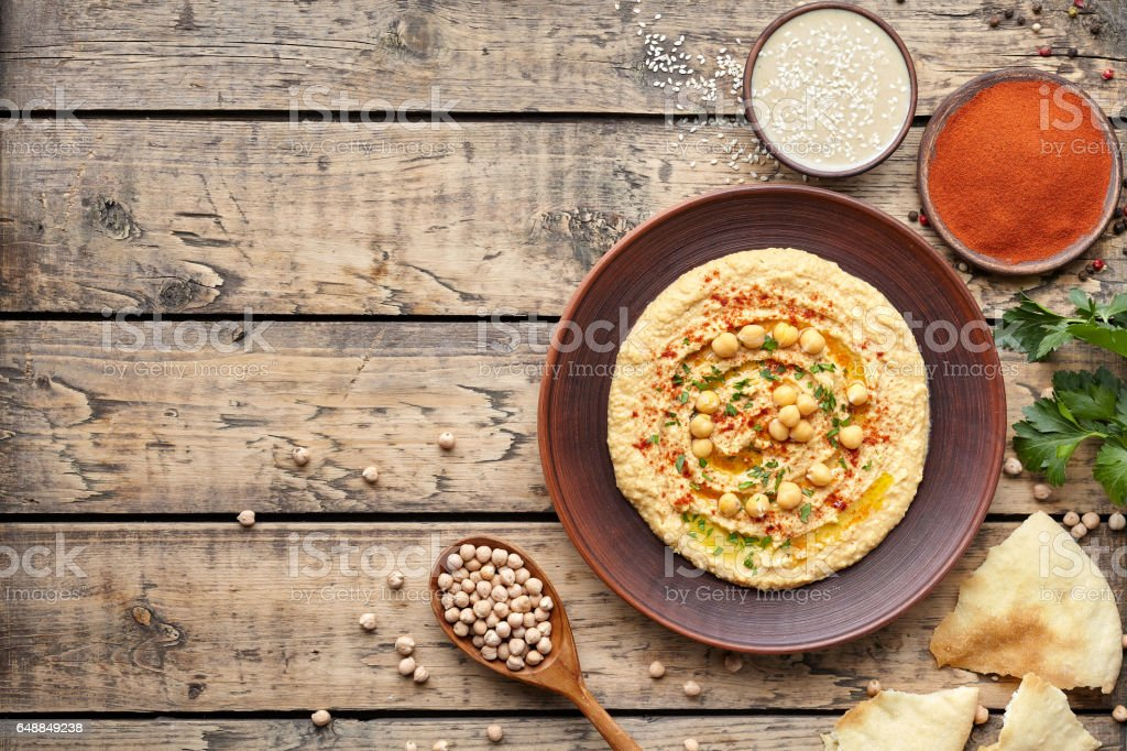 Hummus traditional homemade chickpea vegan natural nutrition lunch dip paste with pita stock photo