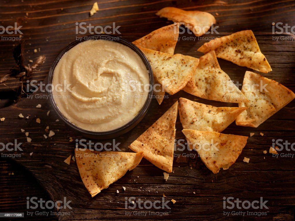 Hummus with Baked Pita Chips stock photo