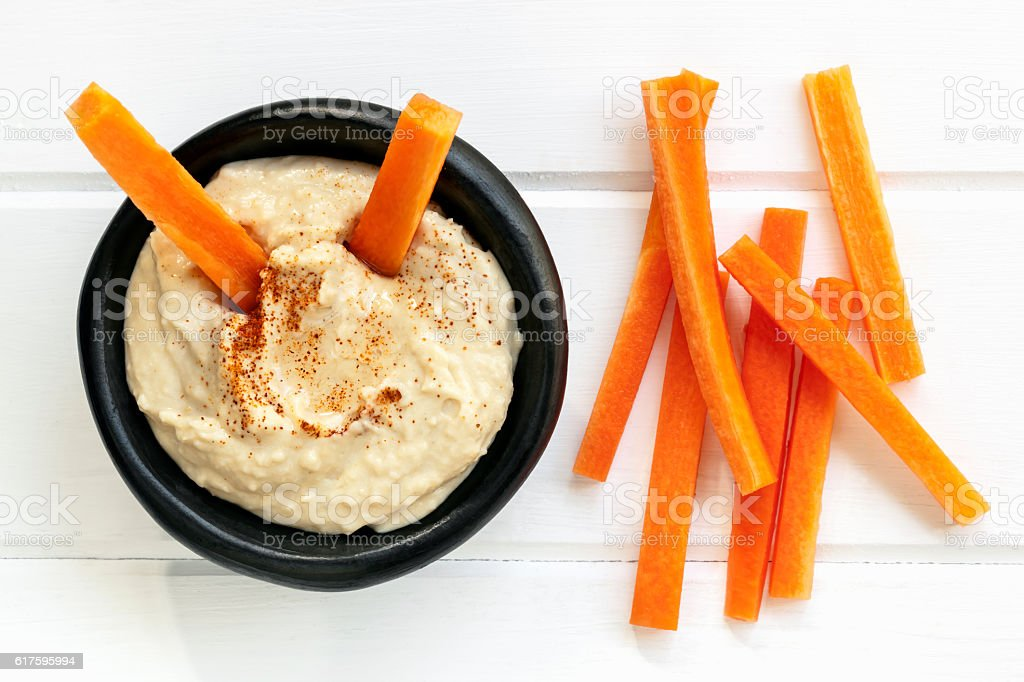 Hummus with Carrot Sticks Top View stock photo
