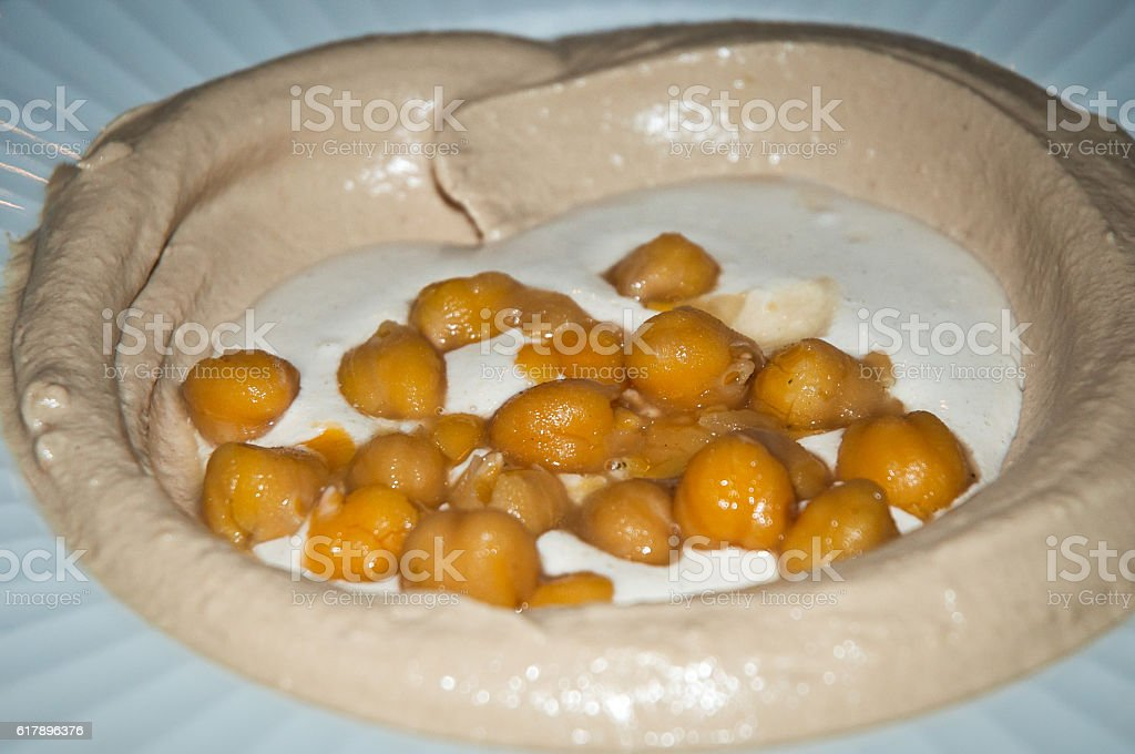 Hummus with olive oil  and beans . stock photo