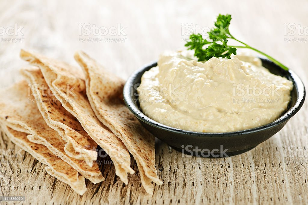 Hummus with pita bread stock photo
