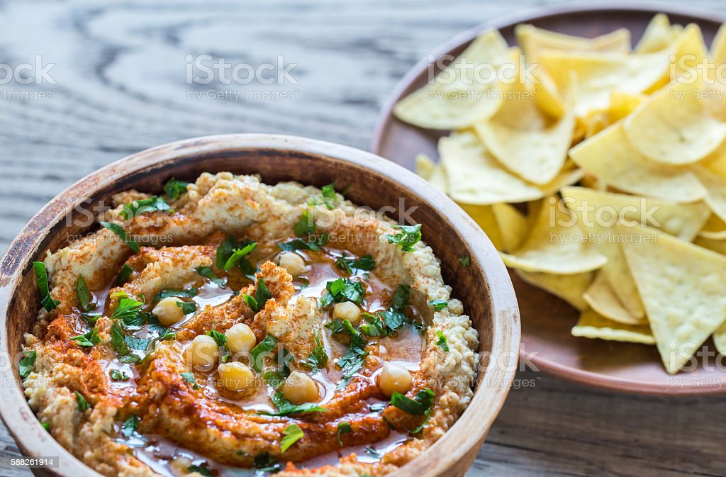 Hummus with tortilla chips stock photo