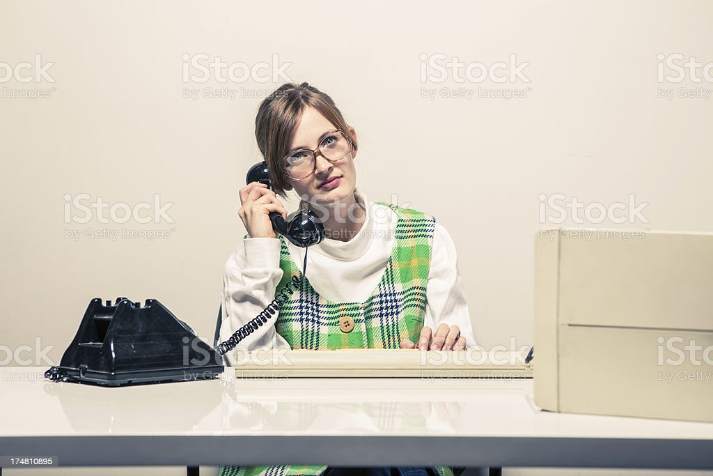 Humorous Businesswoman at the Desk with Serious Expression royalty-free stock photo