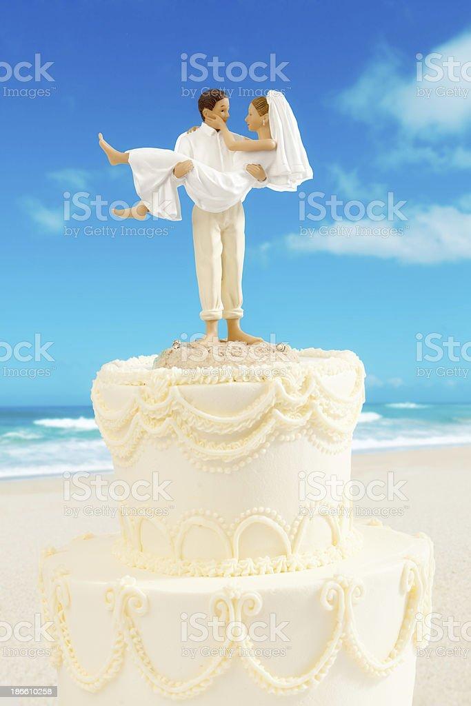 Humorous Destination Wedding Cake Topper on White royalty-free stock photo