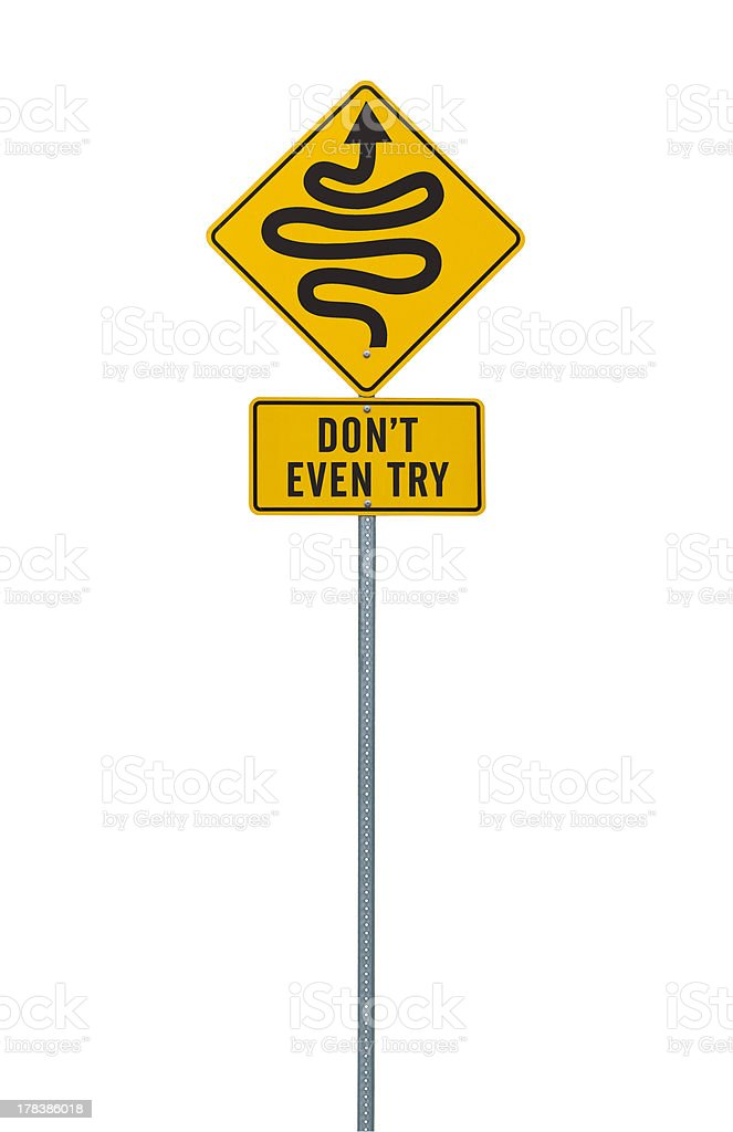 Humorous discouraging road sign with curves isolated on white stock photo