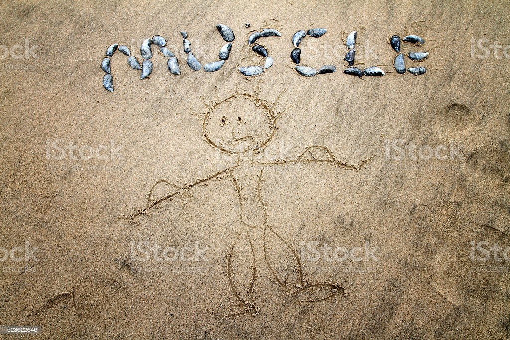 Humorous drawing of muscle man on beach stock photo