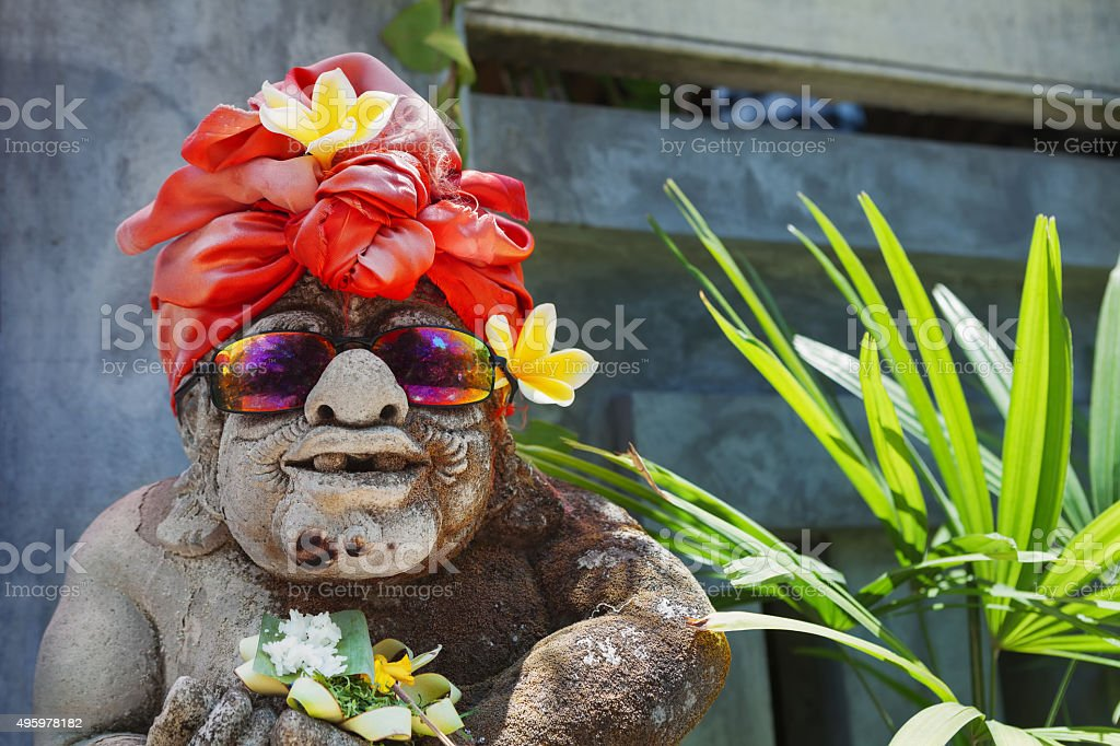 Humorous face portrait of old traditional Balinese temple guard stock photo