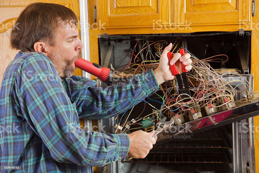 Humorous Major Appliance Repair stock photo