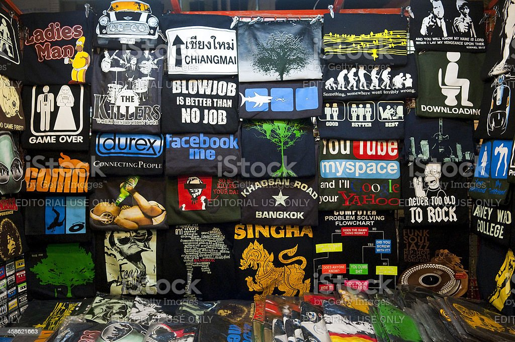 Humorous t-shirts for sale in Thailand royalty-free stock photo