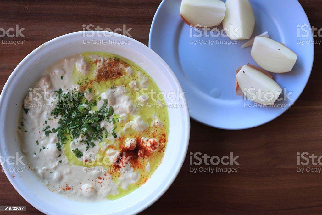 Humus and onions stock photo
