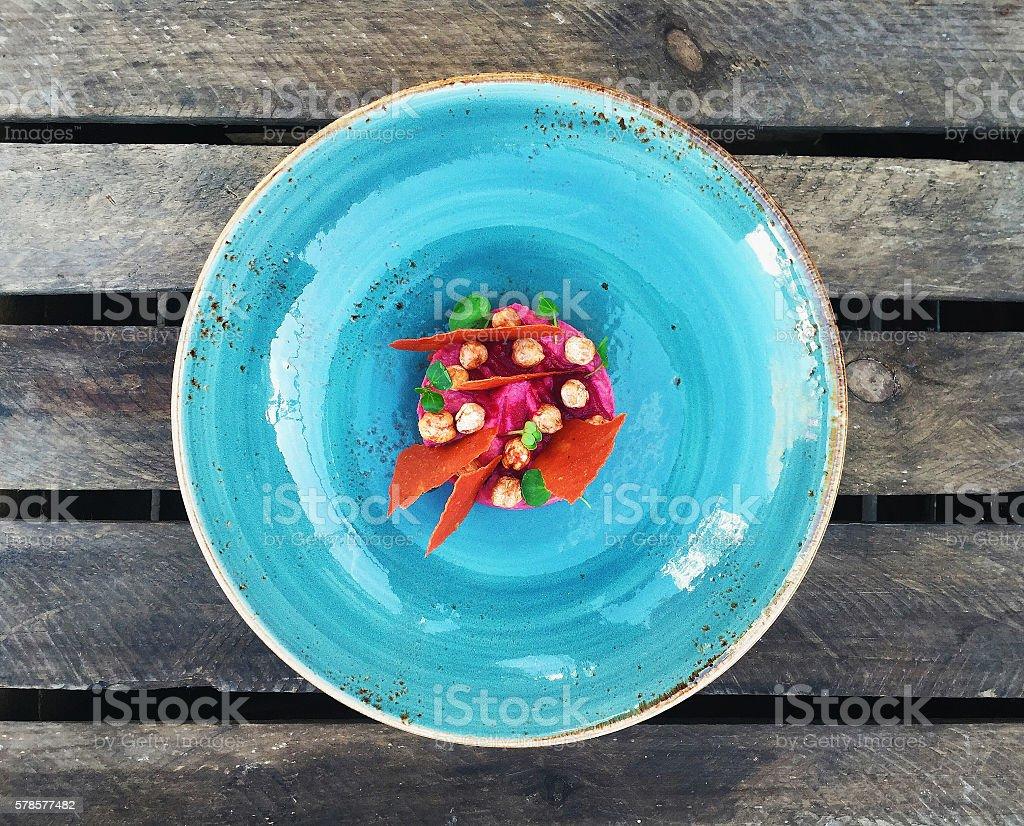 Humus with beet stock photo