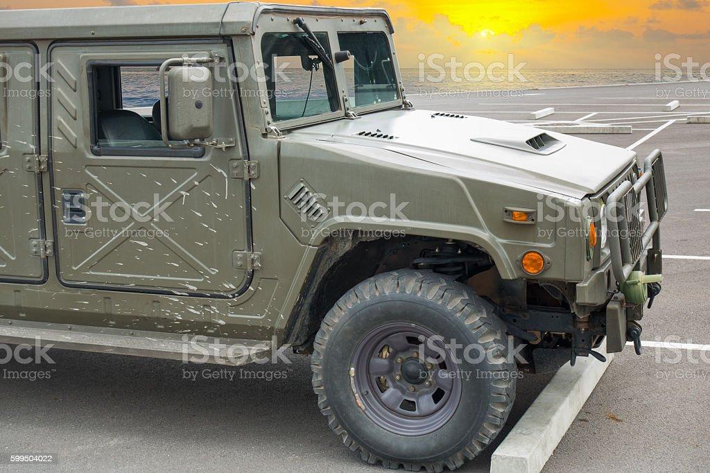 Humvee jeep on sunrise backgrund, Military transportation. stock photo