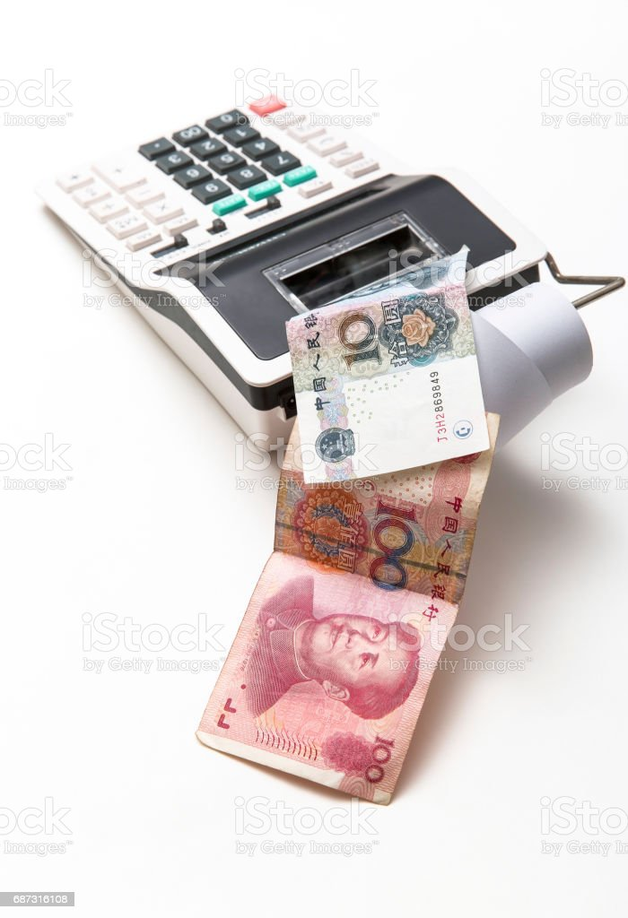Hundred and ten yuan China bills come out from calculator on background stock photo