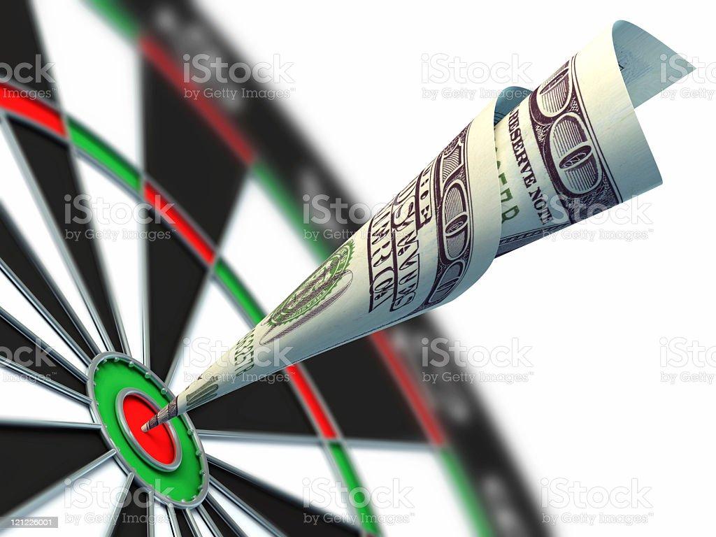 Hundred dollar bill hitting the bullseye of a target stock photo