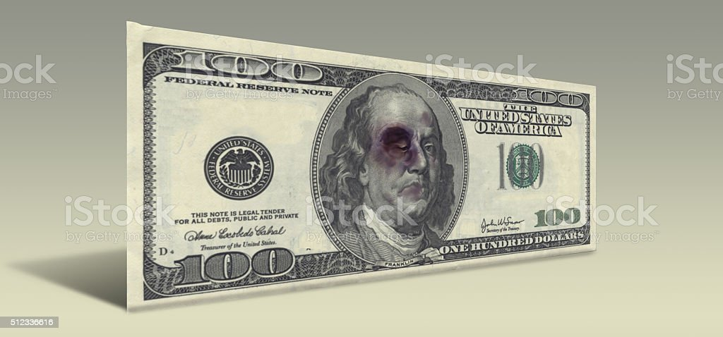 US Hundred Dollar bill with Beaten Ben Franklin stock photo